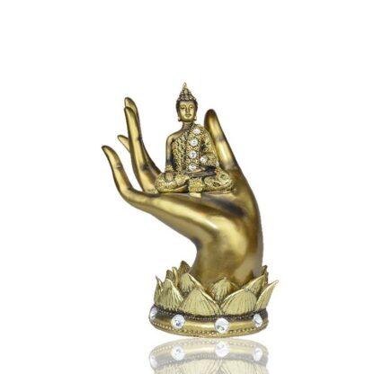 Bouddha Thaïlandais en or antique dans une main